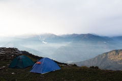 Tents on the top of the mountain in himalayas Stock Photo