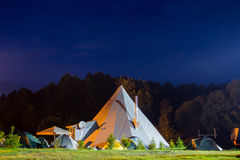 Tents in the tourist camp in a forest glade. Stock Image