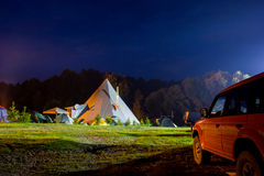 Tents in the tourist camp in a forest glade. Stock Photos