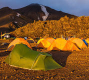 Tents tourists  and glaciers covered with warm sunlight Royalty Free Stock Photos