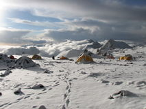Tents under snow in the camp, Andes Stock Photo