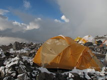 Tents under snow in the camp, Andes Royalty Free Stock Image