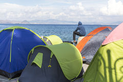 Tents war refugees in the port of Kos island. Stock Photo