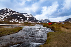 Tents by a wild mountain river Royalty Free Stock Images