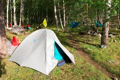 Tents in the woods. Altay. Russia Stock Photo