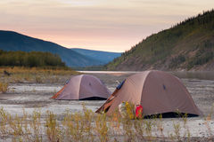 Tents at Yukon River in remote taiga wilderness Royalty Free Stock Photography