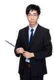 Tenuta asiatica dell'uomo d'affari con il cuscinetto dell'archivio Fotografia Stock