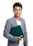 Tenuta asiatica dell'uomo d'affari con il cuscinetto dell'archivio Fotografia Stock Libera da Diritti