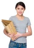 Tenuta asiatica della donna con la cartella Immagine Stock