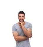 Tenuta casuale Chin Smiling Young Handsome Guy della mano dell'uomo fotografia stock
