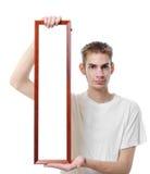 Tenuta del blocco per grafici lungo in bianco Immagine Stock Libera da Diritti