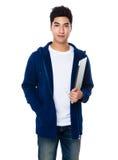 Tenuta del giovane con il computer portatile Fotografie Stock Libere da Diritti