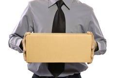 Tenuta del pacchetto Immagini Stock