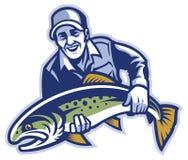 Tenuta del pescatore il grande pesce della trota Immagini Stock
