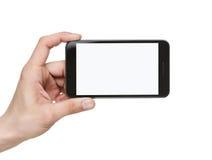 Tenuta del telefono astuto in bianco con il percorso di residuo della potatura meccanica Fotografia Stock