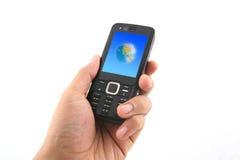 Tenuta del telefono mobile fotografia stock libera da diritti