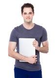 Tenuta dell'uomo con il computer portatile Immagini Stock