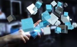 Tenuta dell'uomo d'affari che fa galleggiare renderin brillante blu della rete 3D del cubo Immagini Stock Libere da Diritti