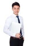 Tenuta dell'uomo d'affari con il computer portatile Fotografia Stock Libera da Diritti