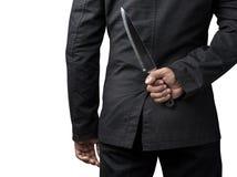 Tenuta dell'uomo d'affari sul coltello fotografie stock
