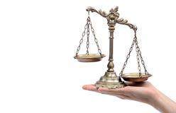 Tenuta della bilancia della giustizia decorativa Fotografie Stock