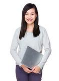 Tenuta della donna con il computer portatile Immagine Stock Libera da Diritti