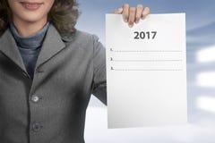 Tenuta 2017 della donna per fare lista Fotografia Stock Libera da Diritti