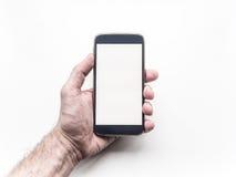 Tenuta della mano dell'uomo e per mezzo dello smartphone mobile Fotografia Stock Libera da Diritti