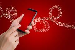 Tenuta della mano e smartphone umani di tocco, compressa, telefono cellulare con il bl Immagine Stock
