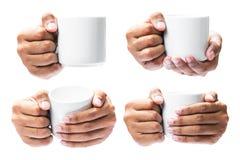 Tenuta della mano sulla tazza di caffè Fotografia Stock Libera da Diritti