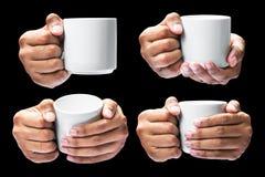 Tenuta della mano sulla tazza di caffè Immagini Stock Libere da Diritti