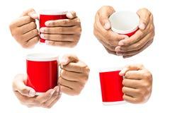 Tenuta della mano sulla tazza di caffè Fotografia Stock