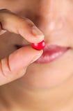 Tenuta della pillola Immagini Stock
