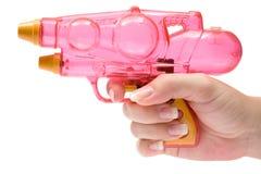 Tenuta della pistola di acqua Fotografia Stock