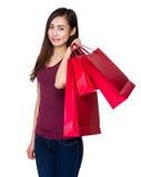Tenuta della ragazza con il sacchetto della spesa Fotografia Stock