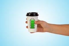 Tenuta della tazza della presa Fotografia Stock