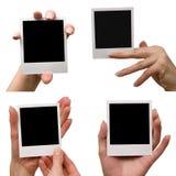 Tenuta delle foto in bianco Fotografie Stock Libere da Diritti