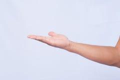 Tenuta maschio della mano sul fondo bianco Fotografia Stock