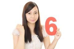 Tenuta numero sei della donna immagine stock libera da diritti