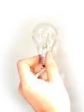 Tenuta una lampadina immagini stock libere da diritti