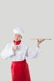 Tenute del cuoco in una mano un vassoio Immagini Stock