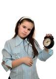 Tenute dell'adolescente in suo orologio della mano Fotografia Stock