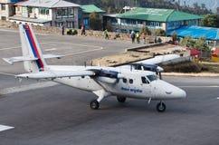 Tenzing-Hillary Airport in Lukla, Nepal. LUKLA, NEPAL - MARCH 4: Tenzing-Hillary Airport the most dangerous airport in the world on March 4, 2014 in Lukla stock photo