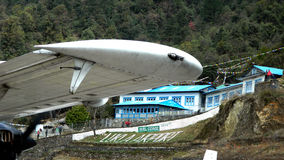 Tenzing-Hillary Lukla Airport. Tenzing-Hillary Airport, also known as Lukla Airport, is a small airport in the town of Lukla, in Khumbu, Solukhumbu district Stock Images