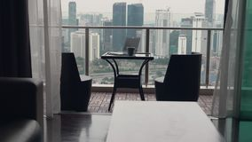 Two chairs at terrace stock video footage