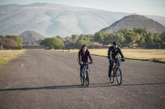 Bike riders on the Avenue of the Dead in Teotihuacan Stock Image