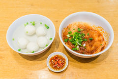 Teowchew Fishball noodles with soup and chili sauce on table Stock Photography
