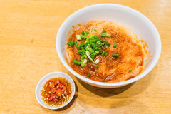 Teowchew Fishball noodles with soup and chili sauce on table Royalty Free Stock Images