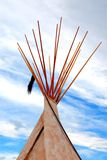 Tepee. Native Indian tepee - wigwam in front of the blue sky's and white clouds stock photos