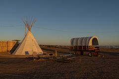 Navajo Campground, Page, Arizona. Tepee and a covered wagon at sunset on a Navajo campground in the United States of America stock photos